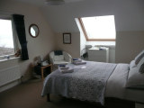 The Blue Room - a double bed en-suite bedroom with spectacular mountain views. Click for bigger picture.
